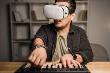 Man in vr goggles using MPC pad
