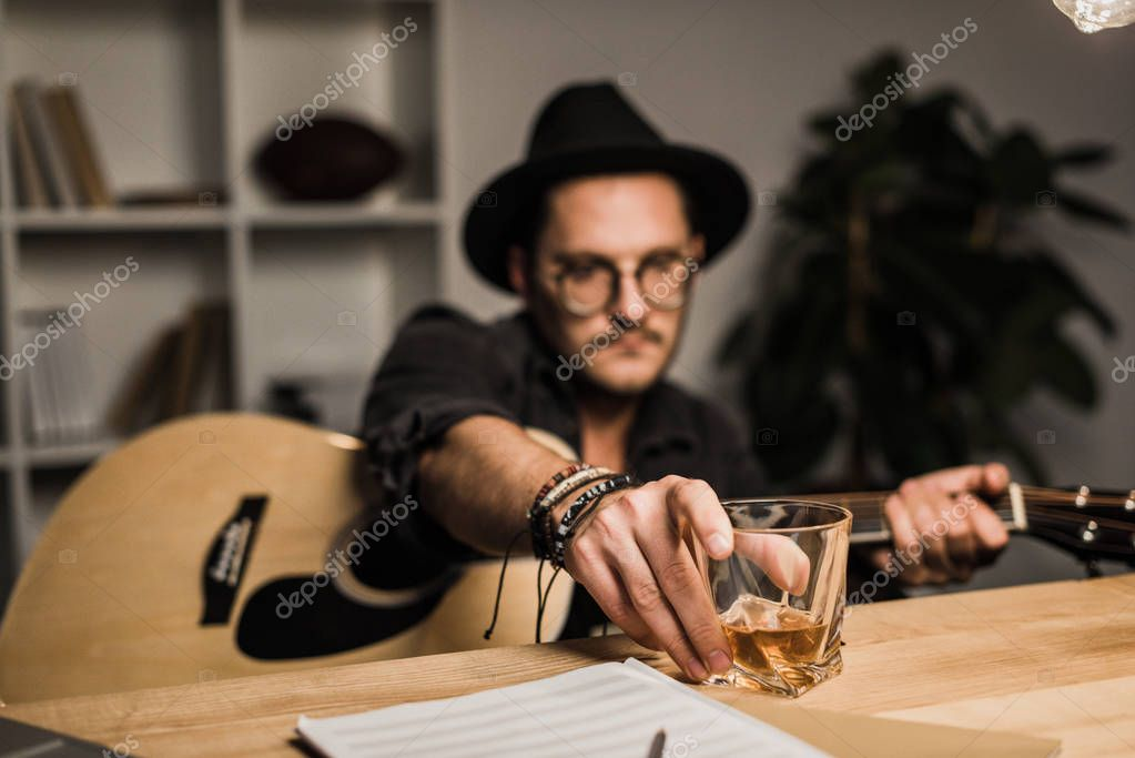 unsuccessful musician drinking alone