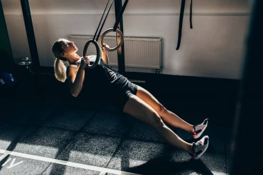 sportswoman on gymnastic rings