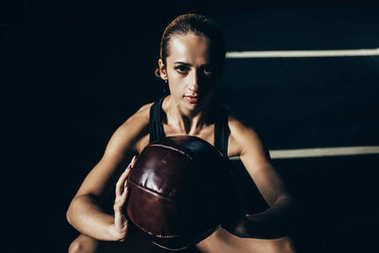 Sportswoman with weighted ball