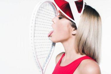 woman in sportswear with tennis racket