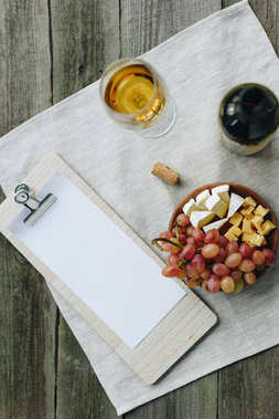 glass with wine and clipboard