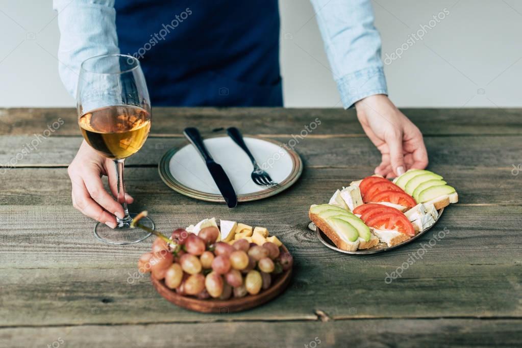 woman taking glass of wine