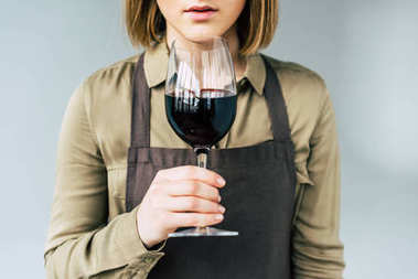 sommelier standing with glass of wine