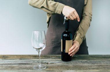 Sommelier opening bottle of wine