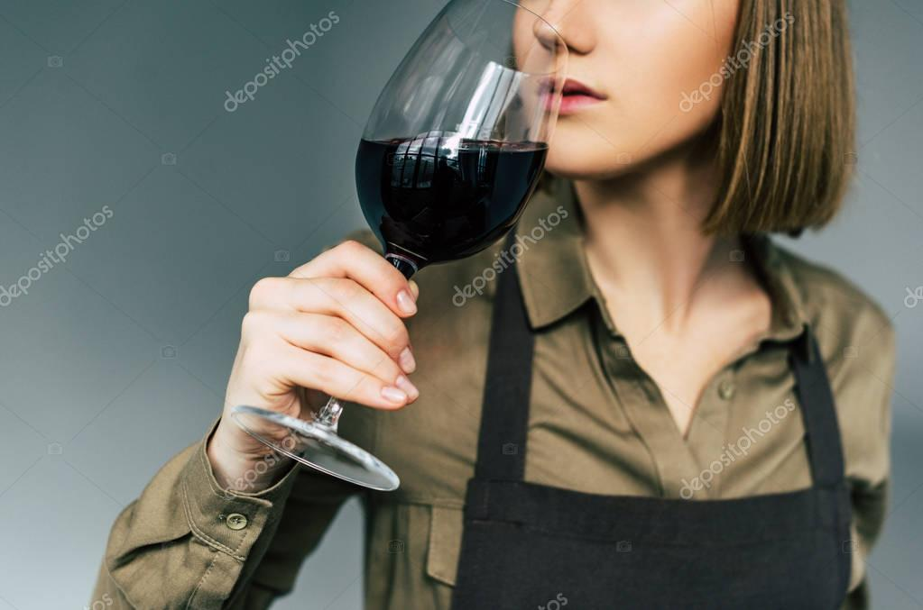 sommelier examining red wine