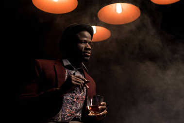 african american man with cognac and cigar
