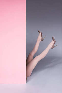 female legs in high heeled shoes
