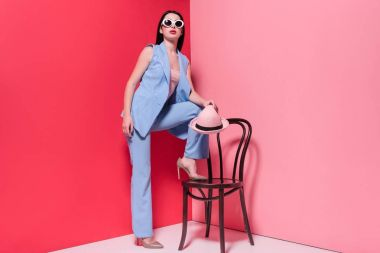stylish girl posing with chair