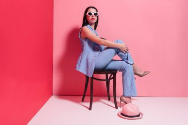 fashionable girl sitting on chair