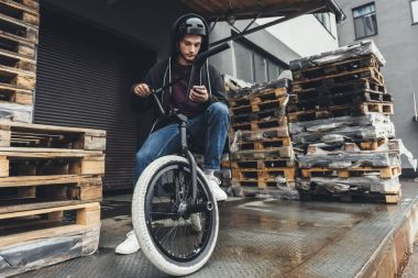 bmx cyclist using smartphone