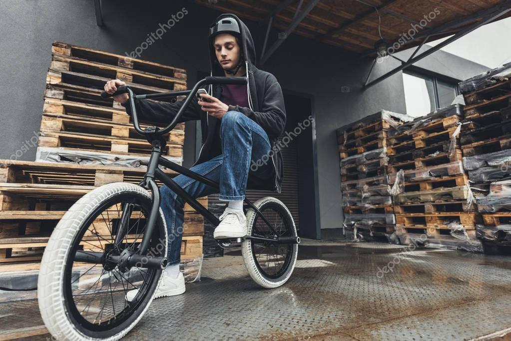 bmx biker using smartphone