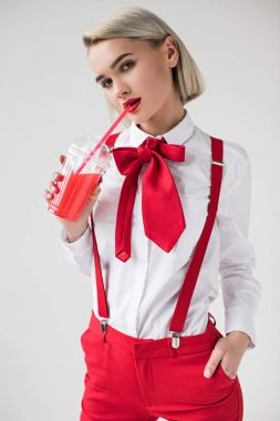 stylish girl with red drink