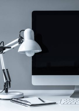 white table lamp and computer with black screen