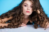 close-up portrait of beautiful young woman with long curly hair