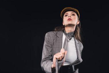 beautiful woman in elegant stylish jacket posing isolated on black