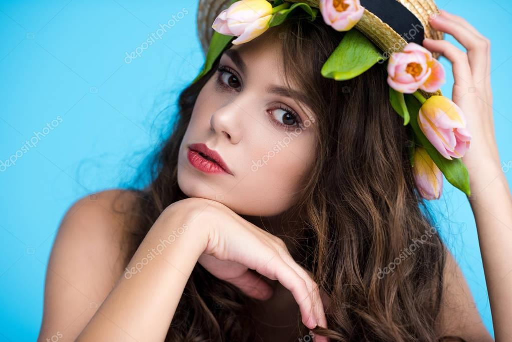 Sensual young woman in canotier hat with beautiful tulips under it stock vector