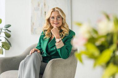 Portrait of beautiful mature woman in eyeglasses smiling at camera stock vector