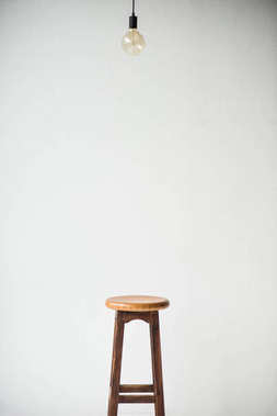 wooden chair and lamp isolated on white