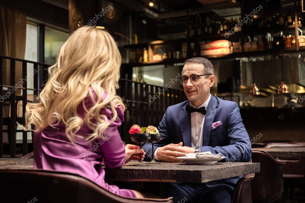 adult couple drinking cocktails at luxury restaurant