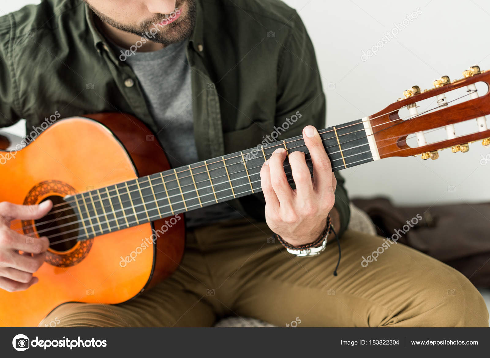 Cropped Image Man Playing Barre Chord Acoustic Guitar Stock Photo
