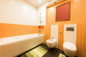 Fotografie close up view of modern bathroom in orange and white colors