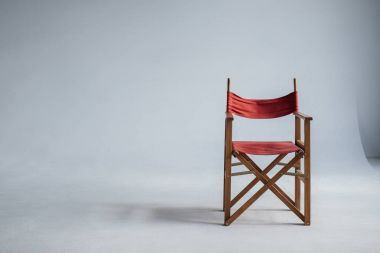 red chair on grey with copy space