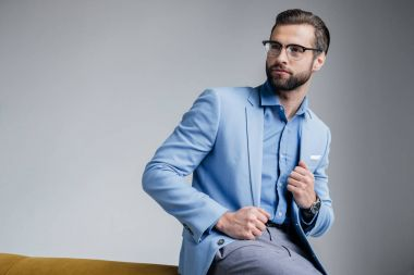 stylish handsome man in eyeglasses and blue trendy suit