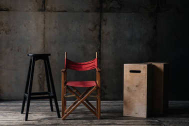 red chair, stool and boxes in loft interior