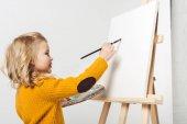 glückliches kleines Kind Malerei auf Leinwand mit Ölfarbe auf Weiß