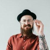 Fotografie smiling bearded handsome man holding glasses isolated on white