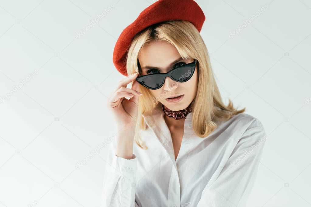 Attractive young woman in red beret isolated on white stock vector