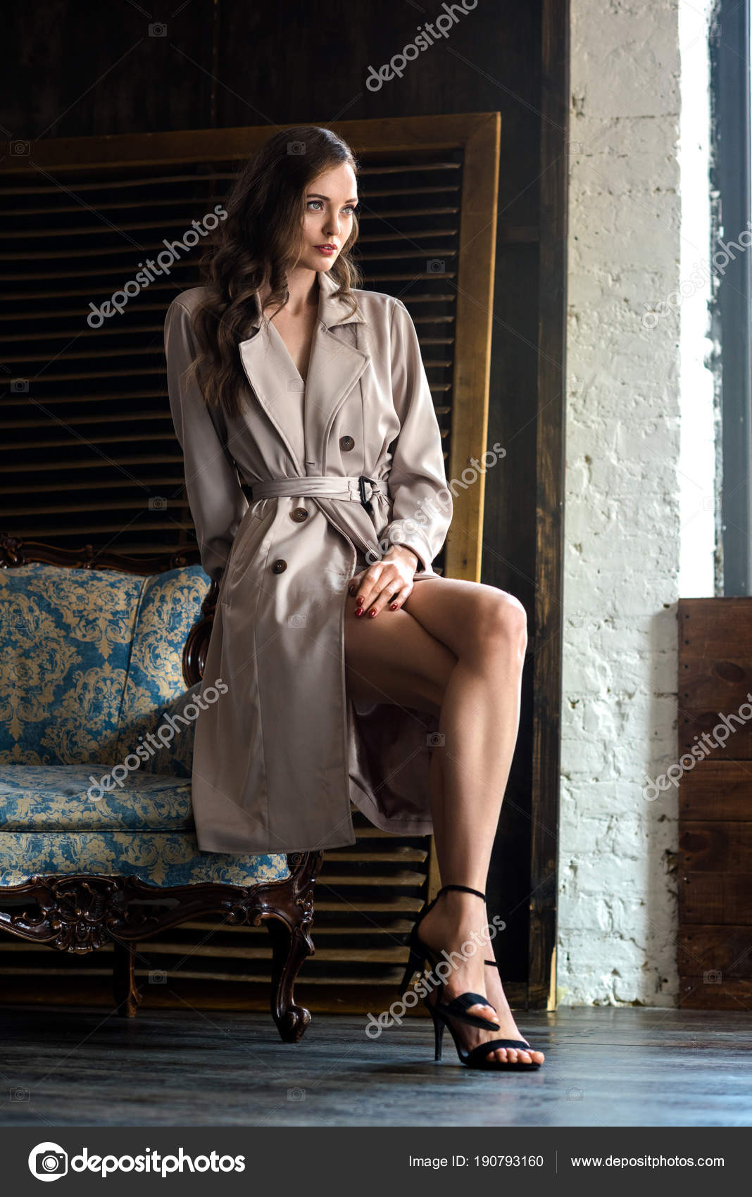 sports shoes 98d62 9638f Elegant Woman Trench Coat Sitting Armchair — Stock Photo © Y ...