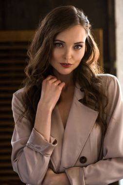 beautiful woman with long hair in beige trench coat