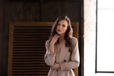 Elegant woman in classic beige trench coat stock vector