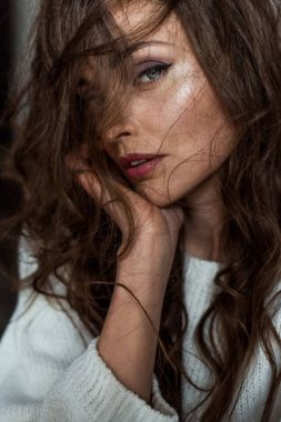 close-up portrait of beautiful seductive brunette woman looking at camera