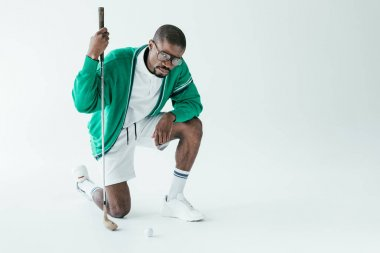 fashionable african american golfer in vintage sportswear, isolated on white