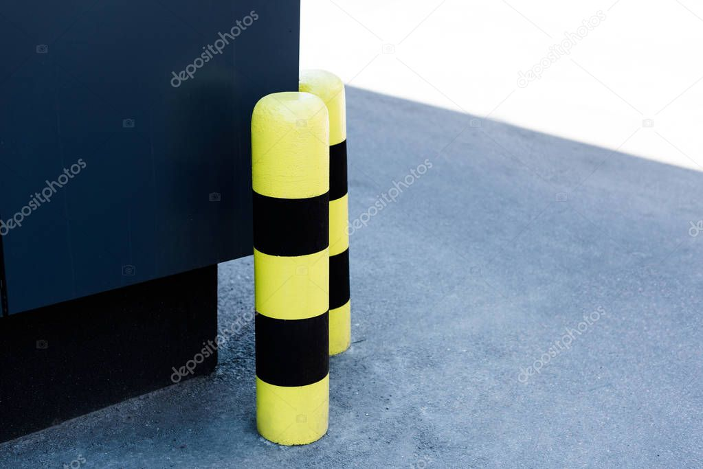Restrictive fence poles on the corner of building