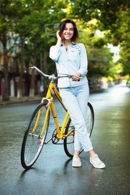 Lovely woman woman with a bicycle