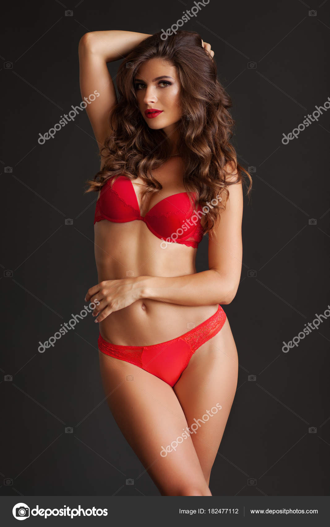 bf92a9116 Pretty elegant lady in beautiful red lingerie against dark gray background  — Photo by ...