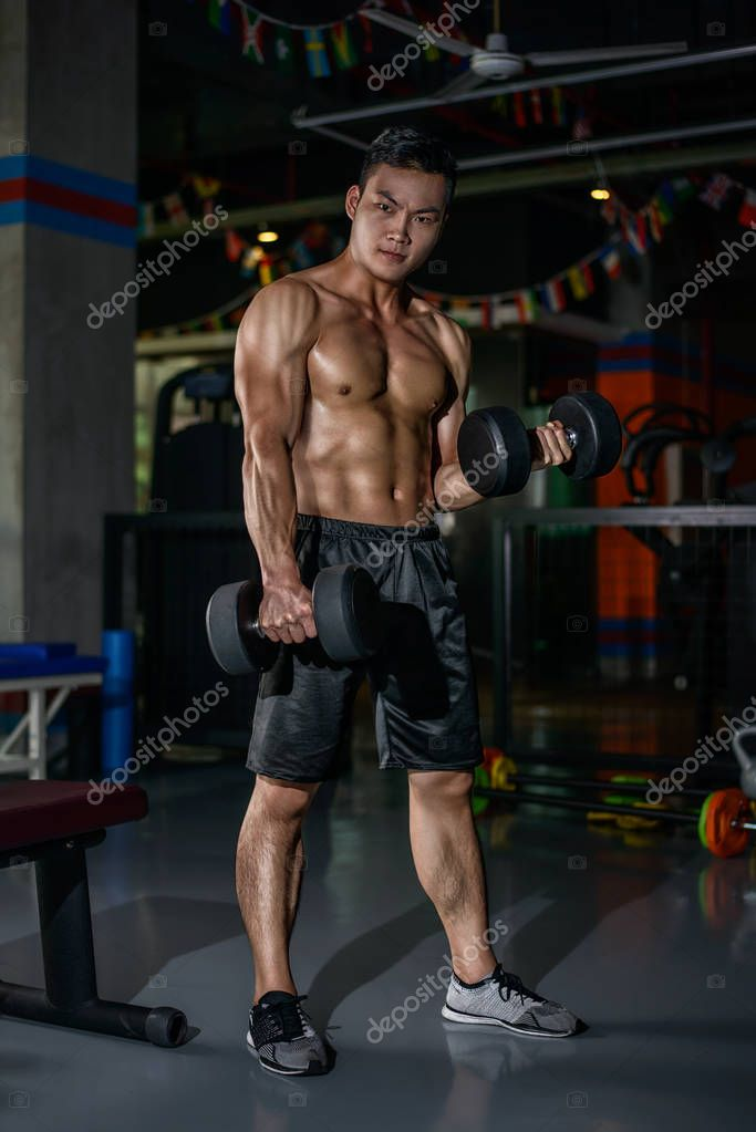 Muscular and fit young bodybuilder | High-Quality Sports