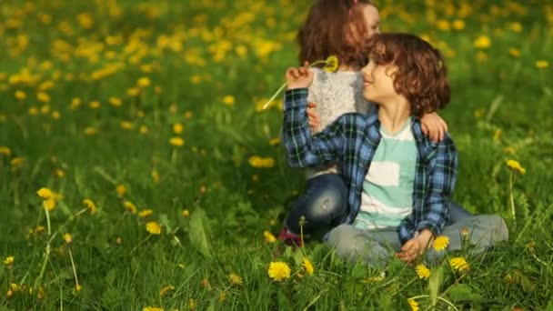 Happy children on the spring meadow.