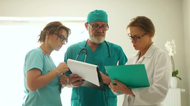 Three doctors discussing a complicated medical case, medical consultation, medicine and healthcare concept