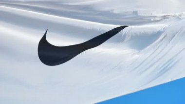 Nike corporation flag in slow motion, editorial animation
