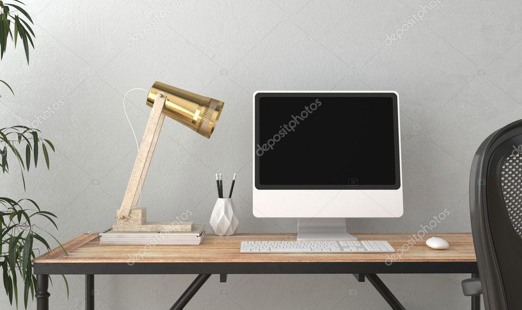 Écran d ordinateur sur le bureau dans la chambre vide