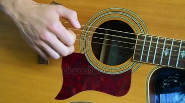 Hand and a part of a guitar playing