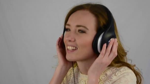 Young woman listening in headphones