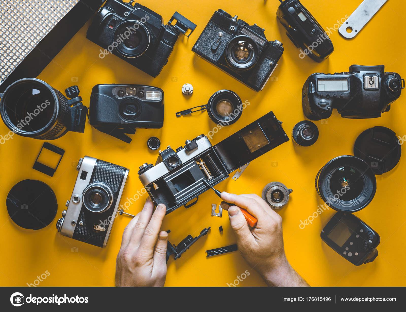 Human Hands Repair Broken Film Camera Top View Stock Photo Lens And Circuit Board Digital Photography Concept