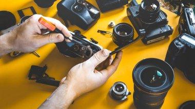 Man Hands Repair Broken Film Camera, Photograph Workplace