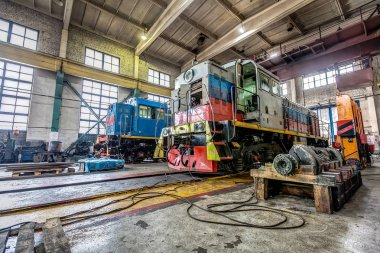 big russian locomotive in the repair workshop for old trains